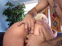 Pretty blonde Rebecca Blue is trying hard to please Tommy Pistol. She sucks his big cock remarcably well and then gets her pussy fucked in side-by-side position and from behind.