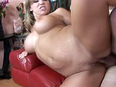 Have fun watching this blonde cougar, with gigantic fake tits wearing a black thong, while she gets fucked hard and moans like a fucking slut!