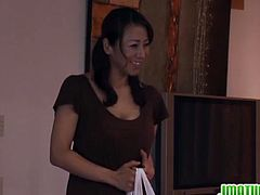 Watch this sexy and busty Japanese mature house wife gets her hairy pussy fingered hard in kitchen before she sits on her knees and suck that fat hairy cock.