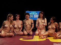 Bella Rossi, Bella Wilde, Cheyenne Jewel, DragonLily, Penny Barber and Syd Blakovich are having fun on tatami. They struggle with each other and then finger each other's cunts and toy them.