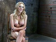 Sexy blonde Samantha Sin gets bound and hung up by some dude in a basement. The guy fingers and toys Sam's pussy ardently and the slut gets the greatest orgasm in her life.