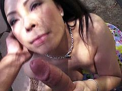 A gorgeous brunette Asian bitch sucks on a hard cock and then gets it shoved balls deep into her fuckin' gash, check it out right here!