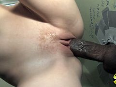 Skinny bitch Beau Marie sucks a fat black cock sticking out of a gloryhole. Then she moves her ass up to the boner and gets fucked like never before.