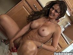 Hispanic mom Monique has some very sexy shapes. Big booty, nice titties and a pretty face. She's about to show us her special recipe for a delicious cocktail. She blends up the ingredients, massages her delicious ass and then positions herself and inserts a speculum in her sweet pussy. She pours it and takes it out