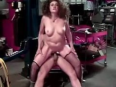Mature woman with curly hair strips her clothes off in the car service. She gives a blowjob to some guy and then gets fucked in a reverse cowgirl position.
