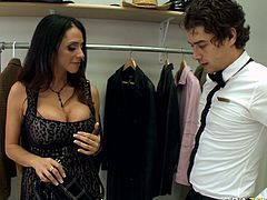 Rich cougar with huge boobs seduces handsome man for sex. She pulls his dong out of his pants and takes hard flesh in her mouth. She also licks balls sensually.
