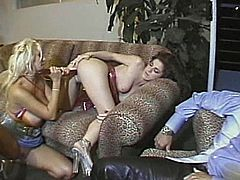 A blonde and a brunette kiss lying on a sofa. Then they take their clothes off and have wild lesbian sex. They finger and toy their pussies with big dildos.