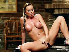 Silvia Saint gives herself some beaver stimulation with the help of her dildo
