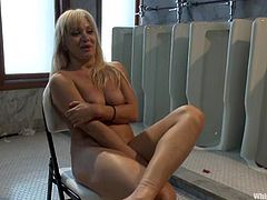 Slutty blonde Lea Lexis is having fun with Lorelei Lee in a public bathroom. Lee binds and suspends Lexis and then plays with her asshole and smashes it with a dildo.