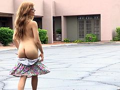 Have a look at this hot scene where a horny redhead teen shows her natural breasts and the rest off her sexy body as she takes off her clothes and walks naked in public.