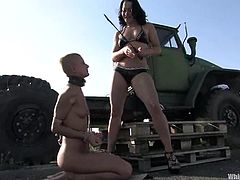 CJ is a bald chick with skinny body. She gets tied up by nasty Sandra Romain. CJ gets her pussy whipped and toyed outdoors.