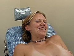 Blonde chick with perky tits lies in a gynecological chair. She gets her shaved pussy toyed hard by relentless fucking machine.