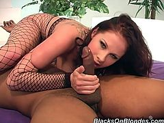Have fun watching this brunette, with big natural jugs wearing a fishnet outfit, while she has interracial sex. She loves going hardcore!