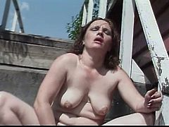 Daylight solo scene with an ugly lady! She spreads her legs wide and starts staffing herself with a huge dildo! So fucking nasty!