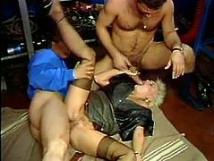 This insatiable punk haired filthy blondie likes harsh MMF fuck. She rides one giant cock in cowgirl pose and gets her loose black eye turbulently banged from behind. Those studs say thax to her by pouring her thirsting face with warm cum. Watch it in The Classic Porn sex clip!