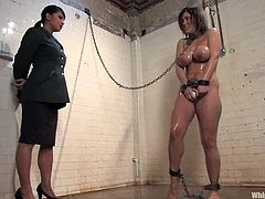 Claire Dames and Gianna Lynn are having fun in a basement. The slave gets shackled and humiliated and then undergoes ardent pussy and ass toying.