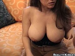 Witness this amateur video where a mature lady with giant knockers gets fucked hard by a muscular dude. She is a wild cougar horny as a bitch!