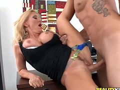 Curvy blonde milf Charity McLain is having fun with some dude in an office. They have ardent oral sex and then bang in missionary, cowgirl and standing positions.