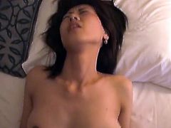 Asian cutie gets screwed savagely. See her screams with pleasure while this guy thrust his hard cock deep inside her hairy pussy. She moans like a real slut.