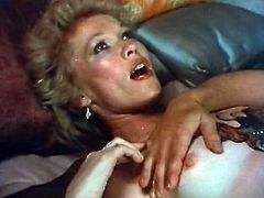 Glamorous light haired mommy lies in bed all naked and pets her shaved pussy with monster dildo. Then MILF rides her cocky lover on top and gets her cunt fucked in doggy pose.