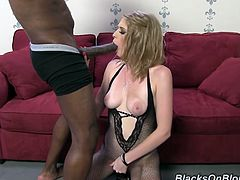 Allie James is a slutty blonde with amazing breasts and a perfect ass. Watch this hardcore scene where she sucks and takes a pounding from a black monster cocks.