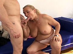 Mature blonde with big boobs gives a blowjob to big cocked guy. After that she takes her pink dress off and gets fucked on a bed. In addition she gets her face cum covered.