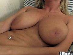 Press play to watch this blonde MILF, with giant love pillows wearing cute panties, while she plays with toys to get a crazy orgasm!