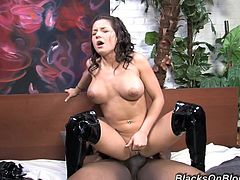 have a blast watching this curly brunette, with giant knockers wearing black boots, while she goes hardcore with a black horny fellow.