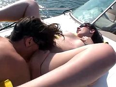 Two brunettes with big boobs have fun on the boat. They take bikinis off and start to eat each others hot pussies.