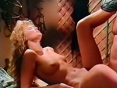 Pretty looking curly haired blondie bitch with massive boobs and sweet ass got her pussy powerfully hammered from behind. Watch this awesome broad assed babe in The Classic Porn sex video!