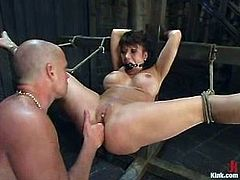 Insatiable bitch Ava Devine allows Mark Davis to bind her in a basement and do all what he wants to with her body. Mark fists the slut's vag, rubs it with a dildo and then drills it as fiercely as he can.