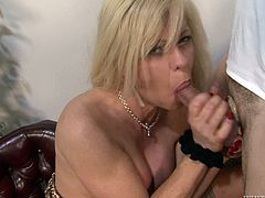 Blonde tranny gets her tits licked and dick sucked. Then Joanna gives a blowjob to the guy and rammed in the ass on a table.