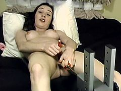 A charming vintage brunette is playing with a fucking machine indoors. She rubs her coochie with a dildo and then gets her pussy drilled by the sex device.