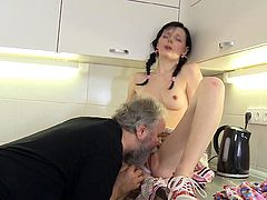 Hot brunette enjoys having both her boyfriend and his dad in a cool threesome