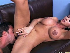 Luscious brunette mom with huge boobs is sucking hard dong deepthroat. She then lies on a couch with her legs wide open getting her slick pussy polished. She then rides big dick on top.