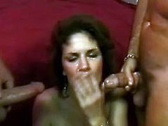 Press play to watch this MMF, where a mature lady gets fucked by two dirty men. She really loves sucking a dick while touching another one!