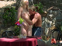 What are you waiting for? Watch this blonde babe, with natural boobs and a hairy pussy, while she gets drilled hard in a romantic place.