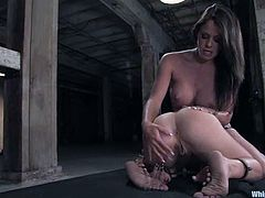 Kylie Wilde and Savannah Stern are playing BDSM games in a basement. The brunette binds the blonde and tortures her in many ways and then makes the slave suck and ride her strapon.