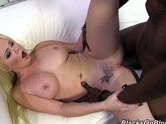 She is with her new boyfriend and she loves his huge black cock. She gives him amazing blowjob and then sits on his rod and rides it like crazy.