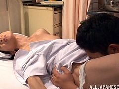 Horny japanese nurse here is stuffing her pretty mouth with his patient's huge dick right in the hospital. Then she lay down and let her guy to suck her hairy pussy which is making her moan with pleasure. When it is ready to take a good pounding the guy starts fucking her like a slut from behind.