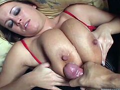 Huge-breasted blonde Brandy Talore kneels in front of some guy and pleases him with a blowjob and a titjob. Then they bang in cowgirl position and Brandy moans loudly with pleasure.