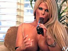 See the vicious blonde milf Sophia Rossi drilling her tight clam into heaven with a big black dildo while assuming very hot poses in this naughty solo video.