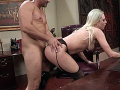 Check this tattooed blonde, with big knockers wearing black stockings and a miniskirt, while she gets nailed hard by a tough fellow.