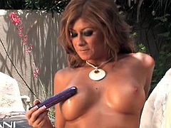 Gorgeous Latina Lisa Daniels is sure to excite you in the most intense of ways as she flaunts her hot body outdoors in her tight white dress. It isn't long before that dress is taken off and she is pleasuring her even tighter pussy with a toy.