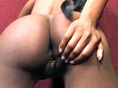 This sexy ebony is waiting to get that gloryhole rod. She sucks it and then spread her legs and take it deep in her cunt before he cum in her mouth.