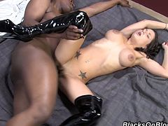 Intense, hardcore action as this white girl keeps her knee high boots on while getting her pussy slammed by a hung black stud.