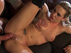 Press play to watch this tattooed lady, with natural boobs and a shaved pussy wearing long boots, while she gets pounded hard by a steamy fellow.