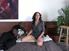 Katie Angel is a hot milf in need of black cock. She seduces Rico Strong, a friend of her son, but her son walks in while she gets pounded from behind. She doesn't care and continues the fun.