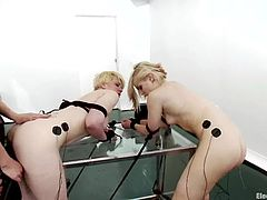 Submissive blonde girls get tied up by a brunette and a redhead chicks. Then these blondes lick each others pussies and get hit with electricity.