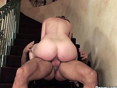 Watch the busty and wild redhead milf Ginger Blaze getting banged on the stair while flaunting her exquisite body.